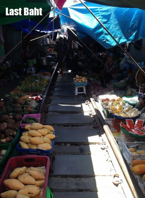 the thai umbrella market set up on train tracks near the station