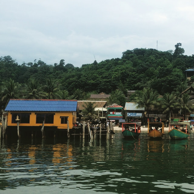 colorful buildings and boats at Koh Rong Island, Cambodia