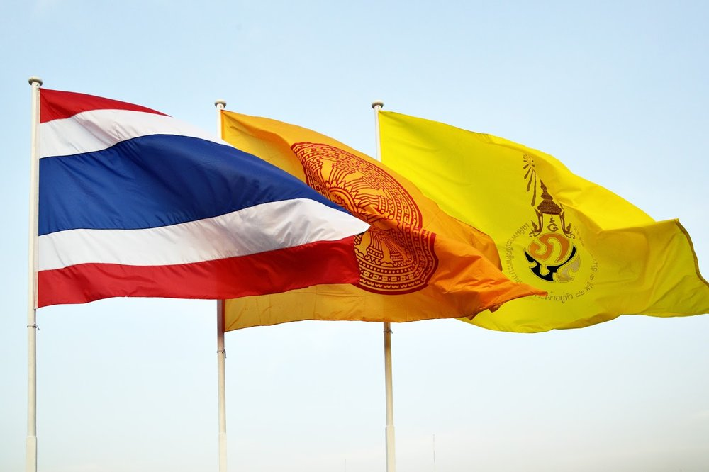 the flag of Thailand, Buddhism, and the King flying in Bangkok