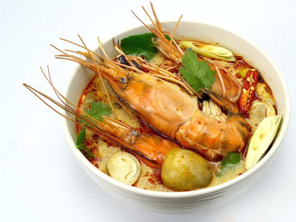 spicy Thai tom yum soup with a large river prawn