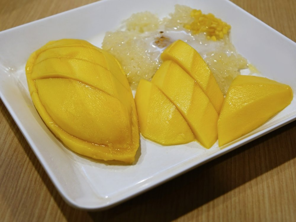 a dish of Thai dessert Mango with sticky rice and coconut cream