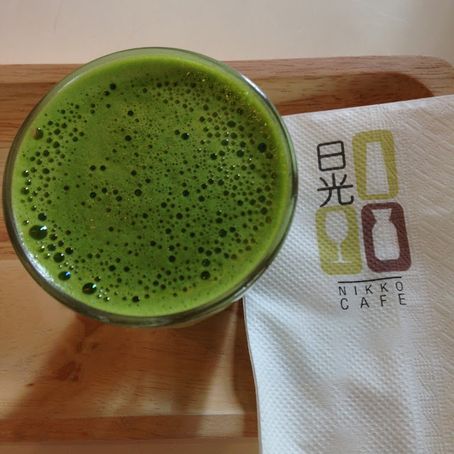 a glass of green matcha tea