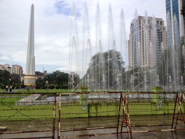 park in yangon surrounded by barbed wire