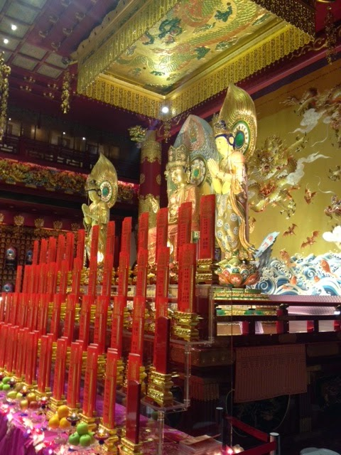 red and gold shrines inside Buddha tooth temple, singapore