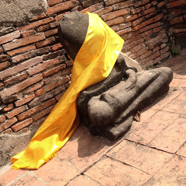 staue wrapped with golden cloth, Thailand