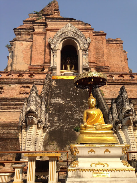 a large Buddhist chedi holding a holy relic at a famous and ancient temple in Chiang Mai, northern Thailand