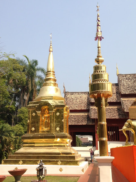 golden chedis in a temple courtyard in Chiang Mai, Thailand