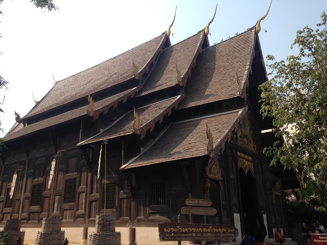 a beautiful teakwood Buddhist temple in Chiang Mai, Thailand