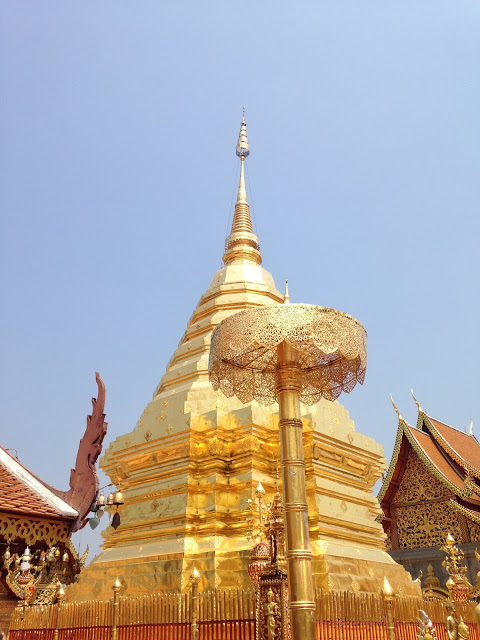 a golden chedi at a temple in Chiang Mai Thailand