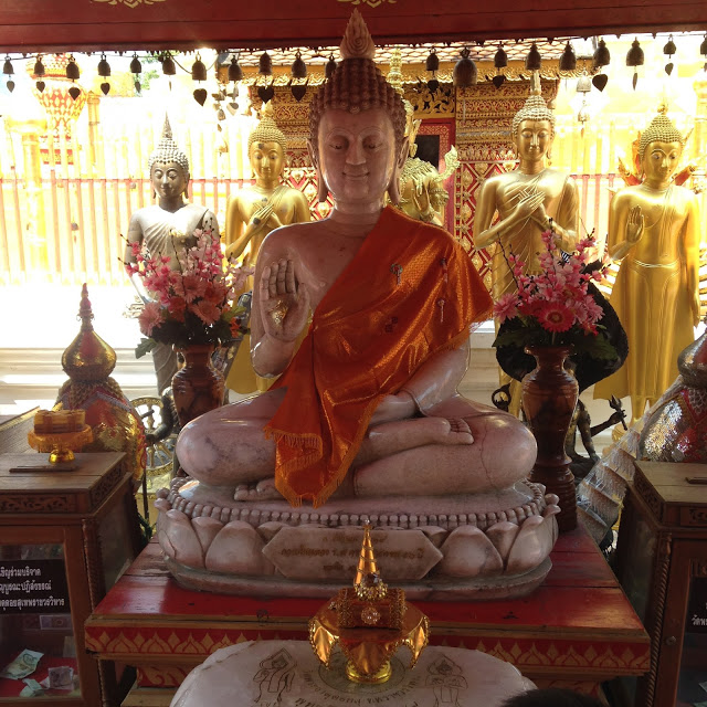 a marble statue of the Buddha at Doi Suthep temple in Chiang Mai, Thailand