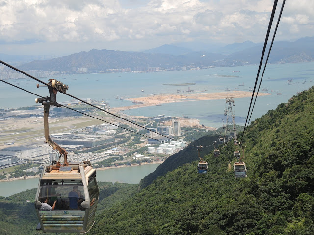 taking the cable cars over Lantau Island in Hong Kong
