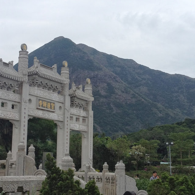 Po Lin, the Precious Lotus Monastery, temple gates against mountain scene in Hong Kong