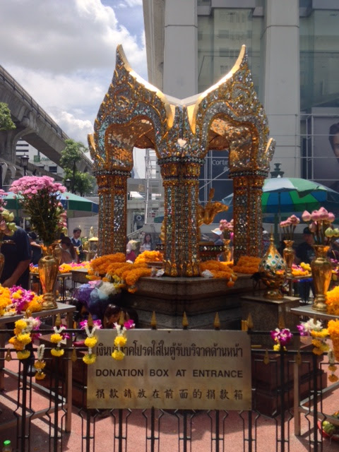flower garlands decorating the Erawan Shrine in Bangkok, Thailand