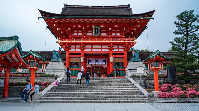 a bright red shrine at fushimi inari in Kyoto, Japan