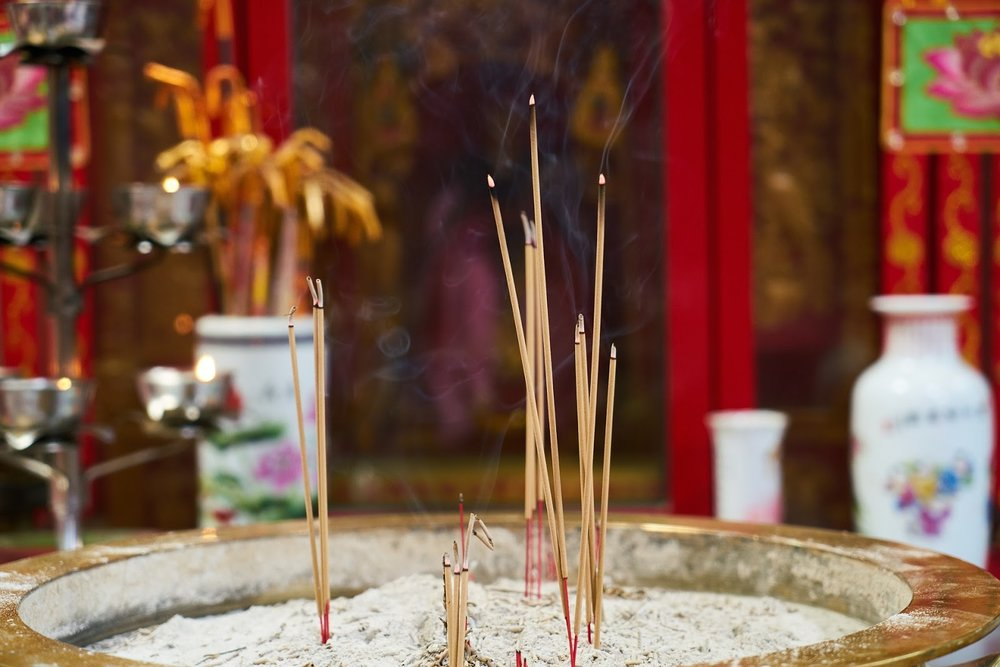 incense burning in front of a Chinese temple