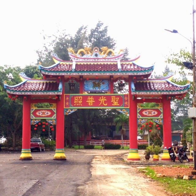 red Chinese temple gates at the entrance to a Buddhist temple in Senggarang, Indonesia