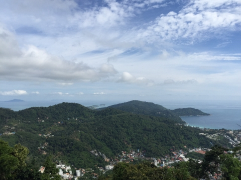 view of green hills, blue sea, and blue sky of Phuket Island, Thailand