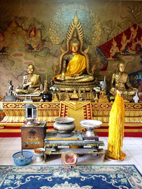 shrines and statues inside a Buddhist temple in pattaya, Thailand