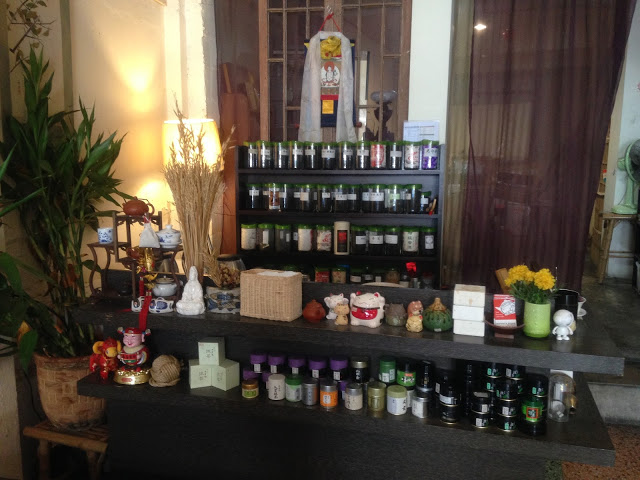 shelves lined with many types of tea inside a bangkok Chinatown tea room