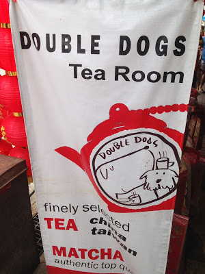 a sign for a tea room in Bangkok's Chinatown