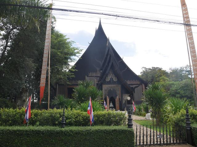 wooden black house Chiang Rai thailand