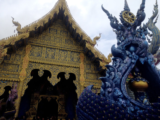 entrance to blue temple chiang rai thailand