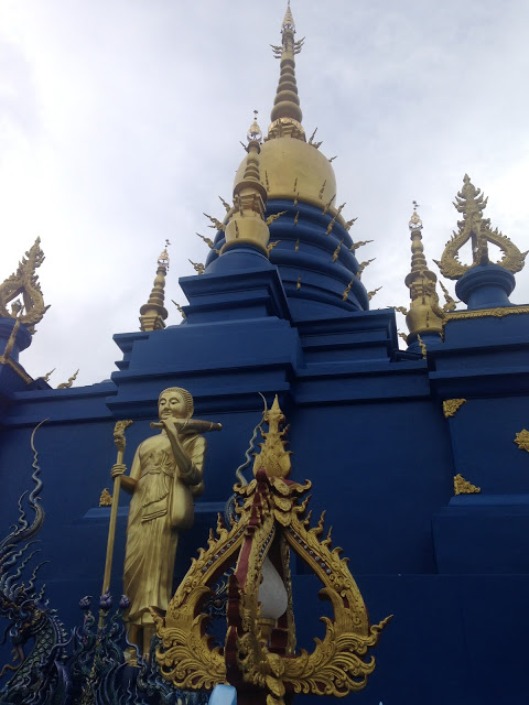blue and gold chedi stupa temple chiang rai thailand