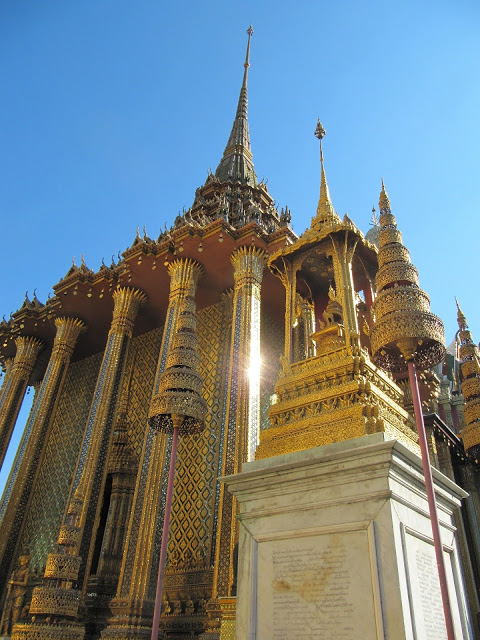 golden temple in bangkok against a bright blue sunny sky