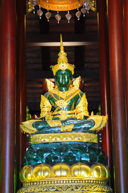 green and gold buddha statue thailand