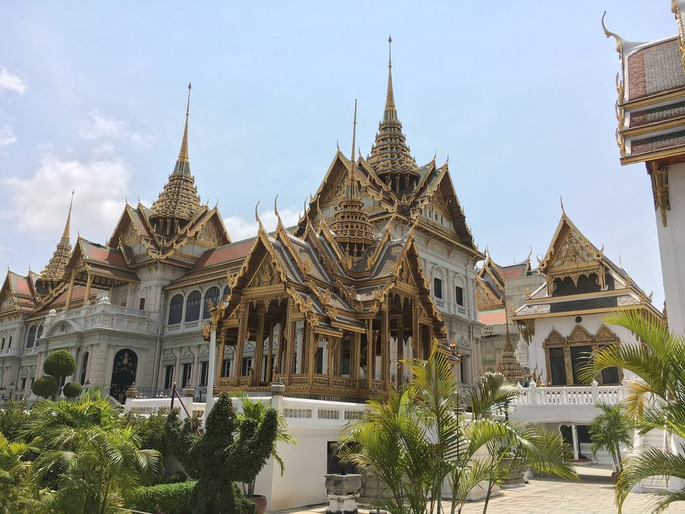 white and gold royal palace, bangkok, thailand
