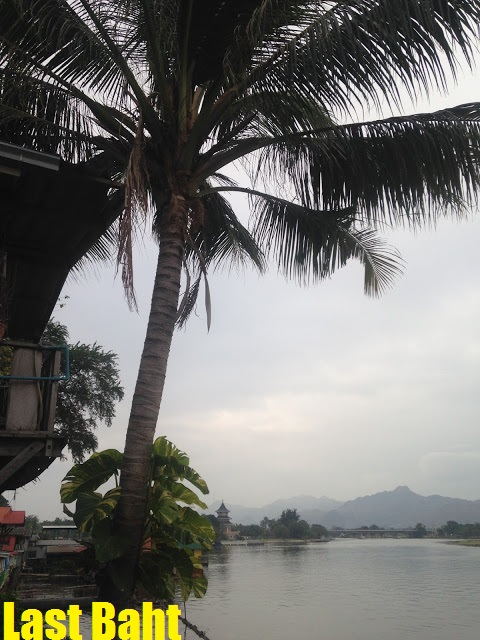 mountains in the distance on the river kwai in Thailand
