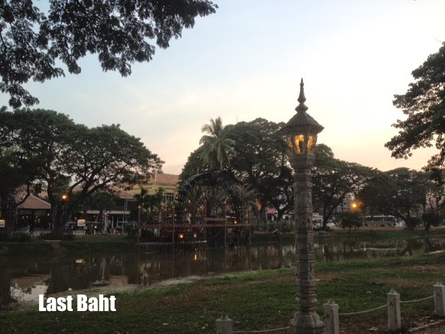 a quiet evening lit by lamps along a river in Siem Reap, Cambodia