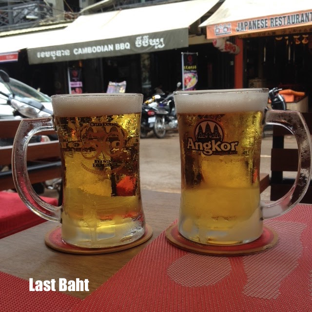 two mugs of ice-cold beer at a small pub on Pub Street, Siem Reap, Cambodia