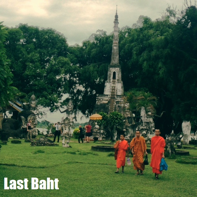 monks with orange robes in Buddha Park