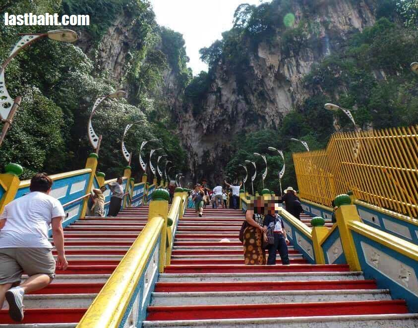 climb 272 steps to the entrance of Batu Caves