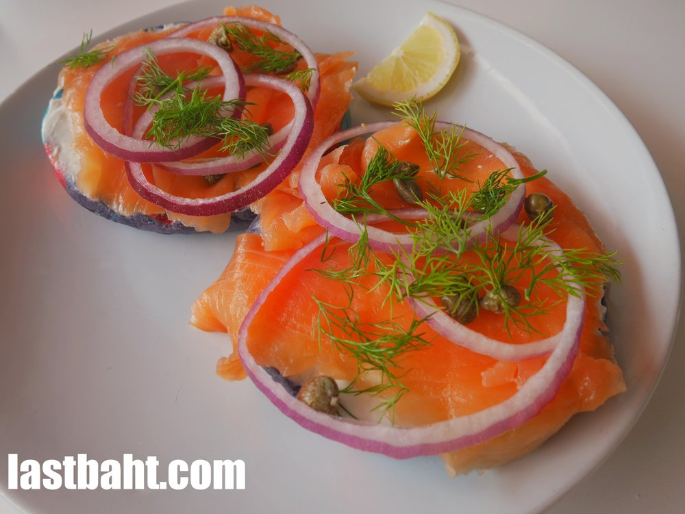 """Lox, Stock, and Bagel"" served on a cool, colorful bagel"
