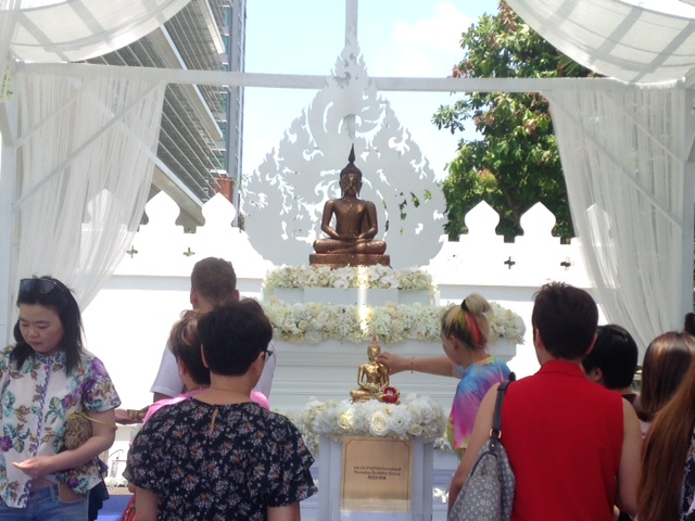 washing a Buddha statue before playing the Songkran Festival at King Power Mall, Soi Rangnam, Bangkok