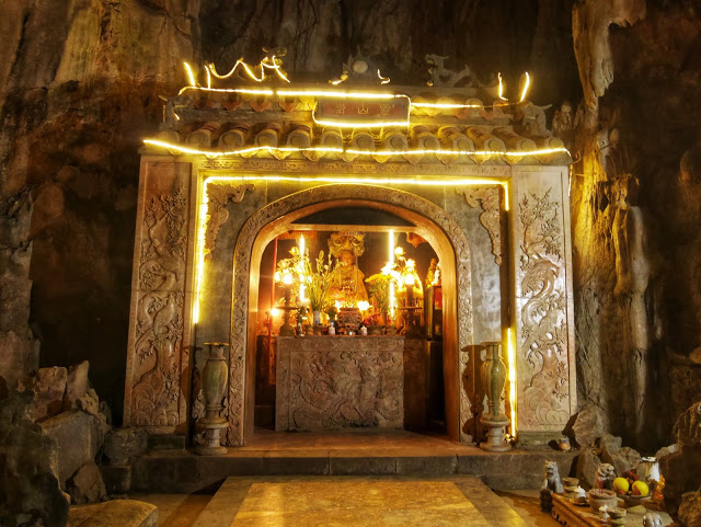 a shrine carved out of the rock inside the cave