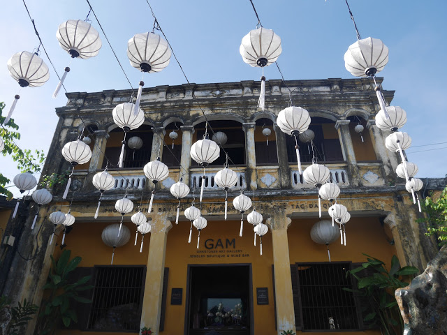 traditional shop with lanterns in Hoi An, Vietnam