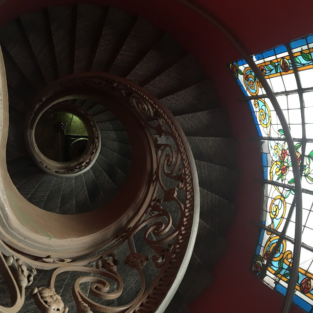 spiral staircase and stained glass windows