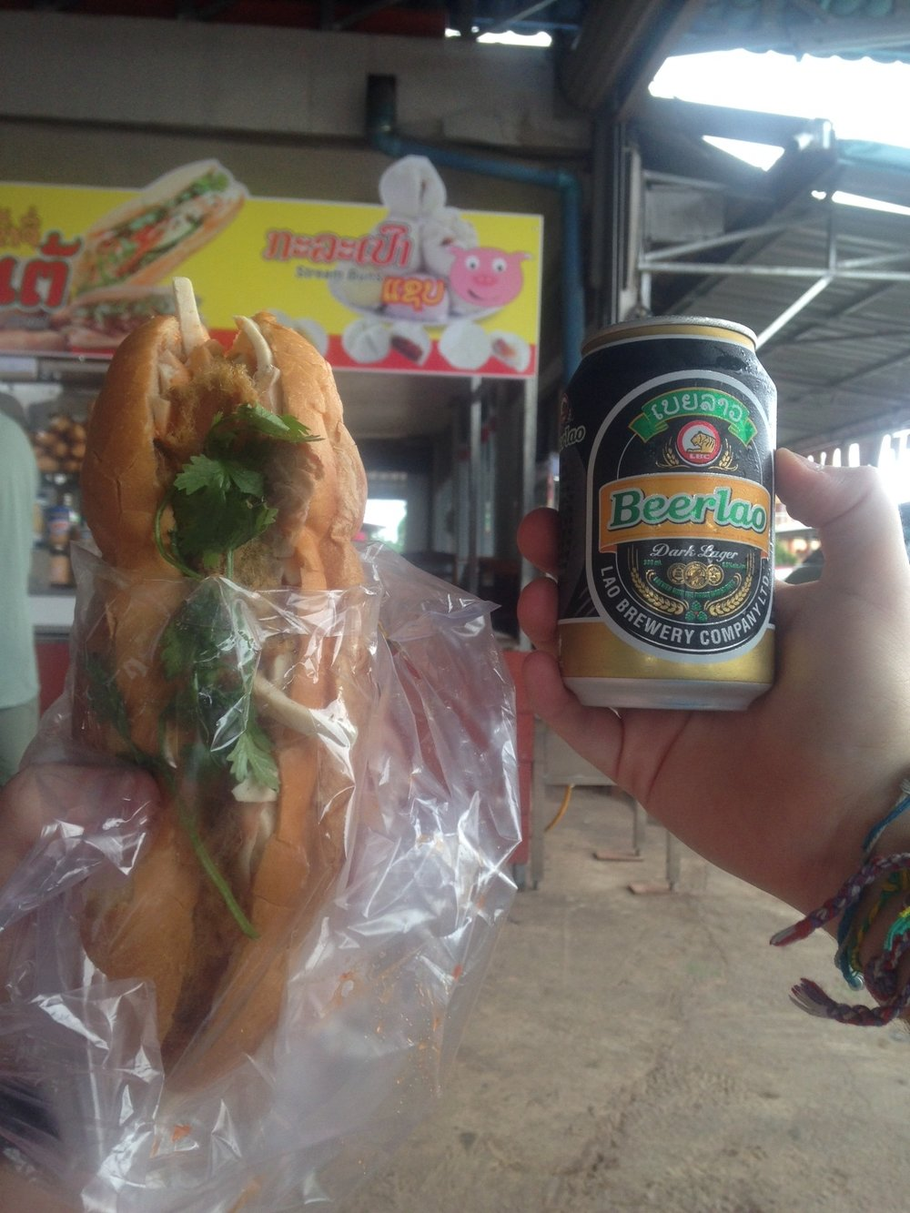 "Laotian sandwich ""khao ji"" and a can of Beer Lao Dark - a nice lunch on the road"