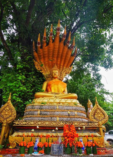 statue of Buddha and Naga serpant