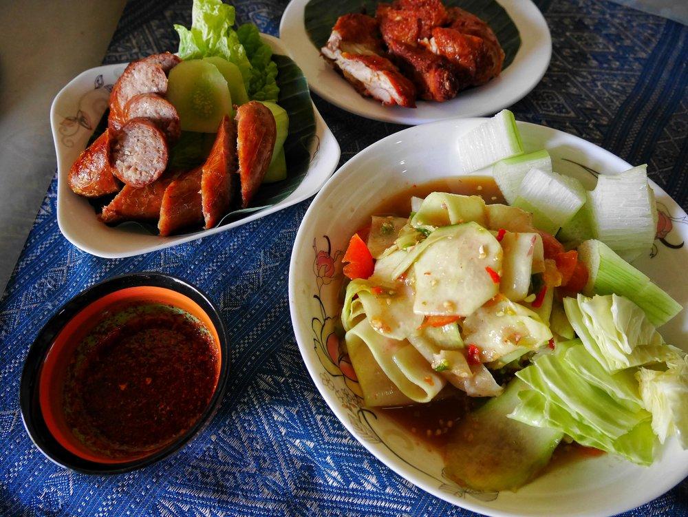 Superb Laotian Food; Papaya salad, fried chicken, Lao sausage