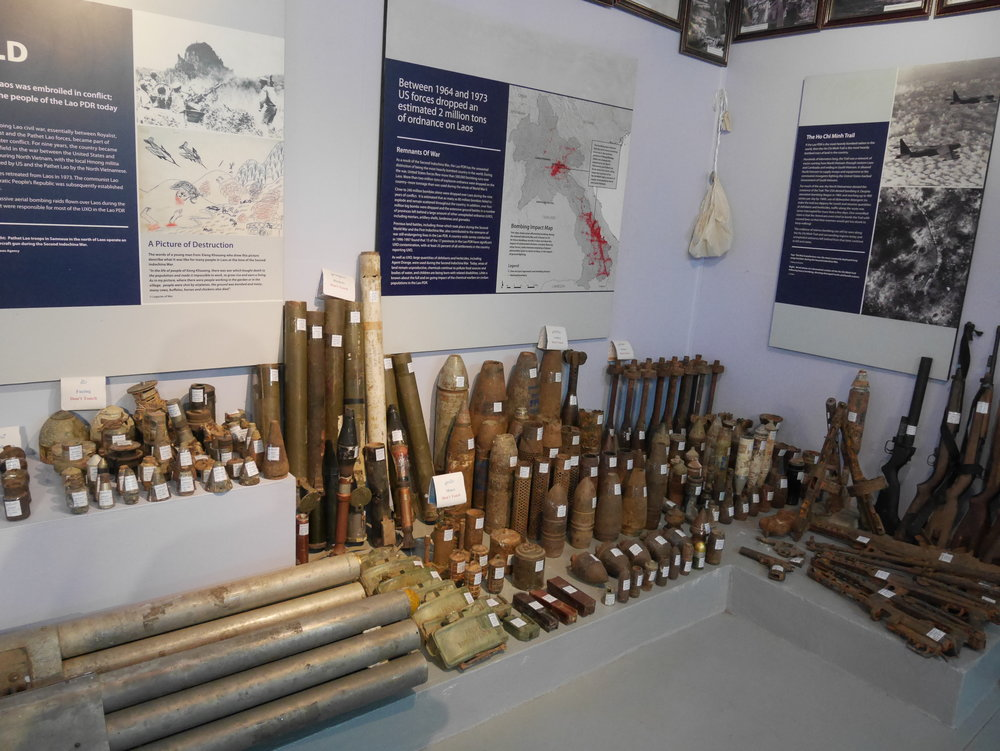 casings from various explosives dug up all throughout the country on display at the UXO Museum in Luang Prabang, Laos