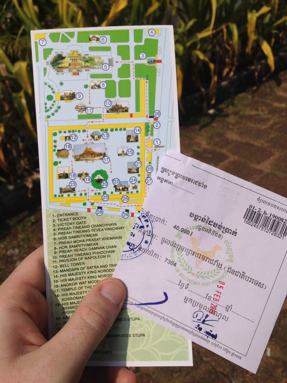 An entry ticket (40,000 khr or $10) to the Royal Palace and a map of the palace grounds.