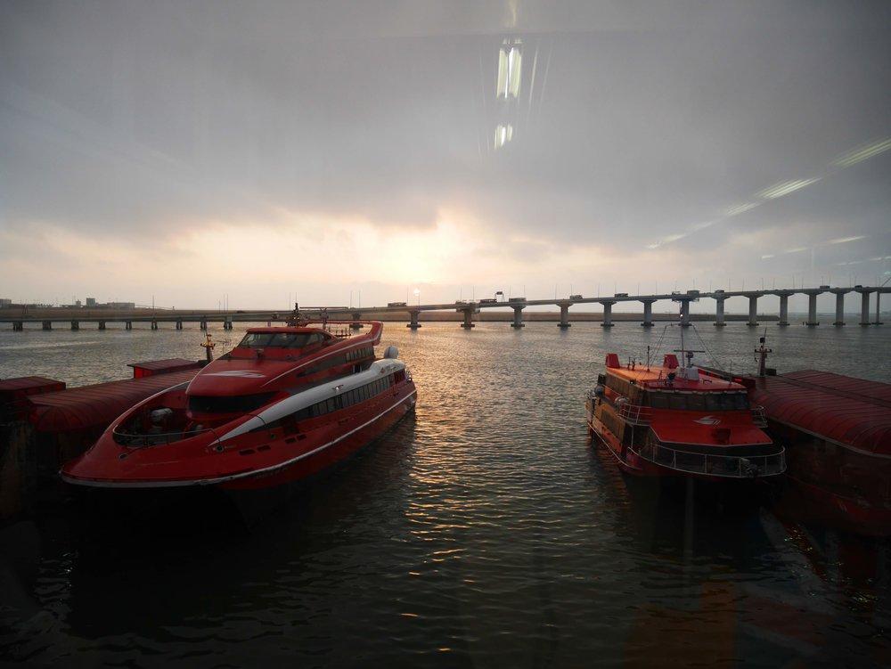 Two types of Macau-Hong Kong Ferry boats waiting to depart