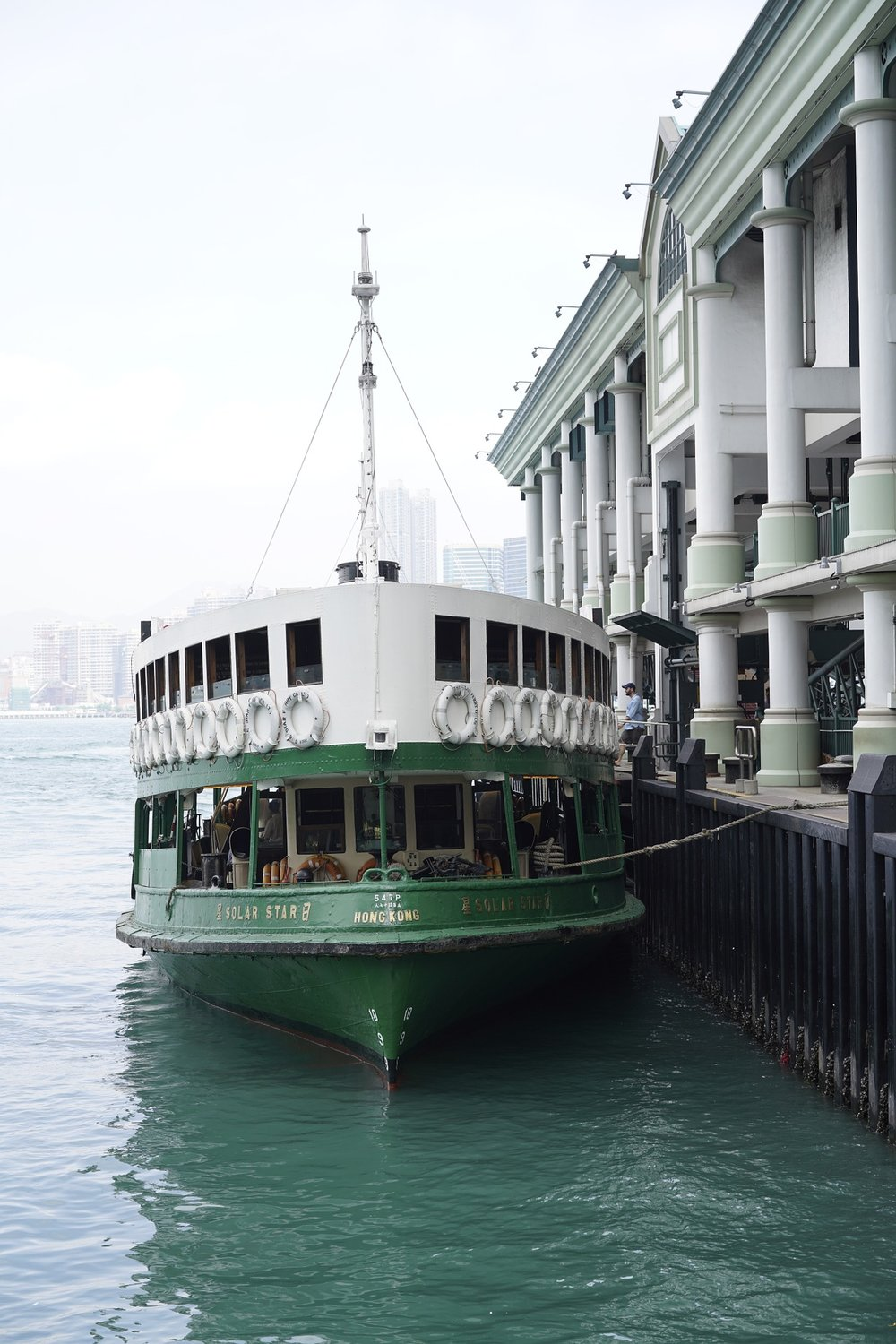 The Hong Kong Star Ferry docked at the ferry terminal. (via Pixabay)