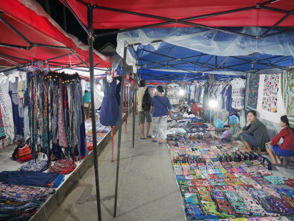 vendors with souvenirs at the Luang Prabang Night Market in Laos
