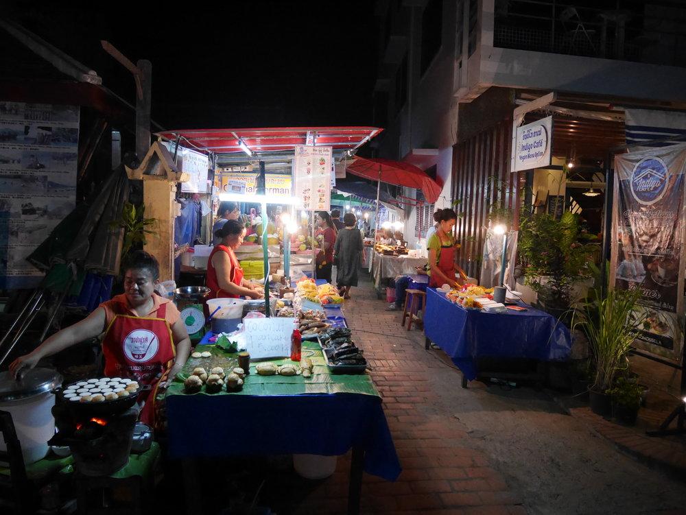 street vendors preparing food and snacks at the Night Market in Luang Prabang, Laos