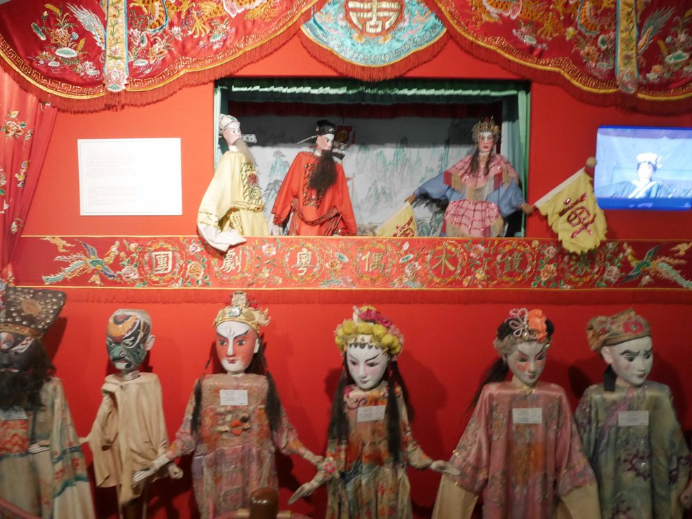 Chinese puppets on display inside the Macau Museum
